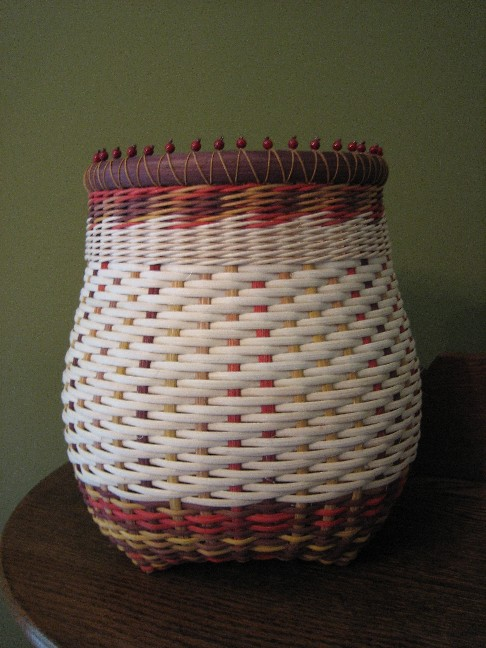 http://www.featherbaskets.com/kit%20files/Beaded%20Autumn%20Cathead.jpg