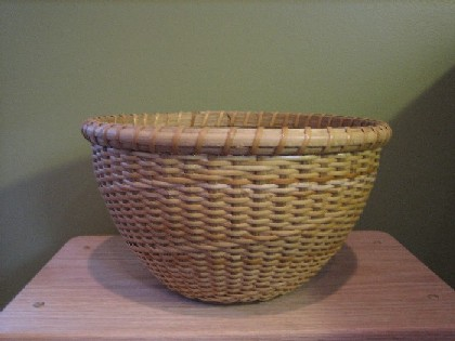 http://www.featherbaskets.com/kit%20files/Eds%20Fruit%20Bowl%20Basket.jpg
