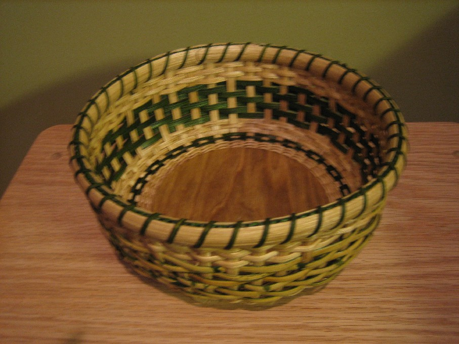 http://www.featherbaskets.com/kit%20files/Tortoise%20Shell%20Roll%20Basket%20(1).jpg